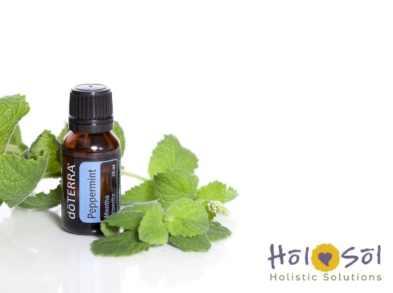 image of doterra peppermint essential oil with mint leaves on white background